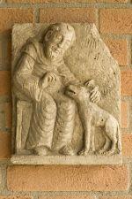 Francesco e il lupo,scultura su pietra