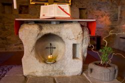 stone altar in the small chapel, the first church at Bose
